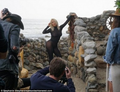 Flaunting her curves: Kim posed sticking her hip out, highlighting her famous curves