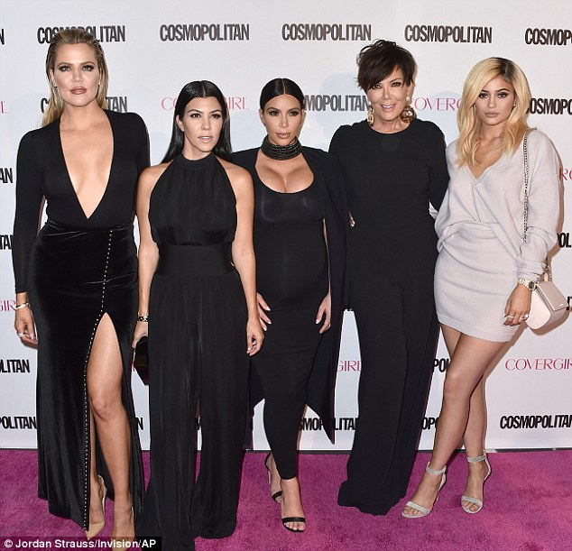 A family affair: (From left) Khloe, Kourtney and Kim Kardashian, along with mother Kris Jenner looked chic in black at Cosmopolitan magazine's 50th birthday party in Los Angeles in Monday, as Kylie bucked the trend in white
