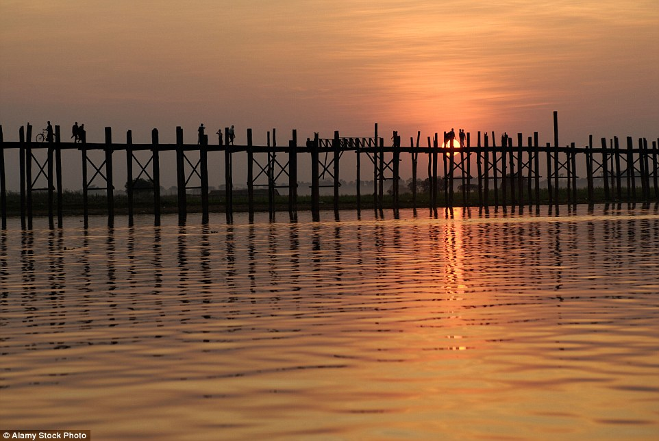 Spanning nearly a miles across the                              Taungthaman Lake in Myanmar, the U-Bein                              Bridge is a rickety platform made of                              teakwood. The bridge is held together on                              both sides with 1,086 pillars that come up                              out of
