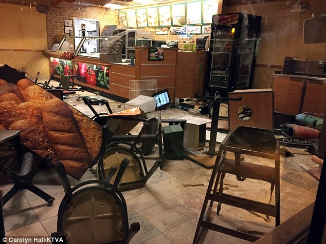 Chaotic scene: Employees at this Subway in Anchorage, Alaska, are cleaning up one serious mess today left by a woman apparently under the influence of Spice that destroyed the restaurant on Tuesday night