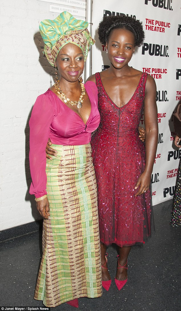 Colorful looks: Lupita chatted with costar Akousua Busia, who wore a bright green patterned skirt and headress
