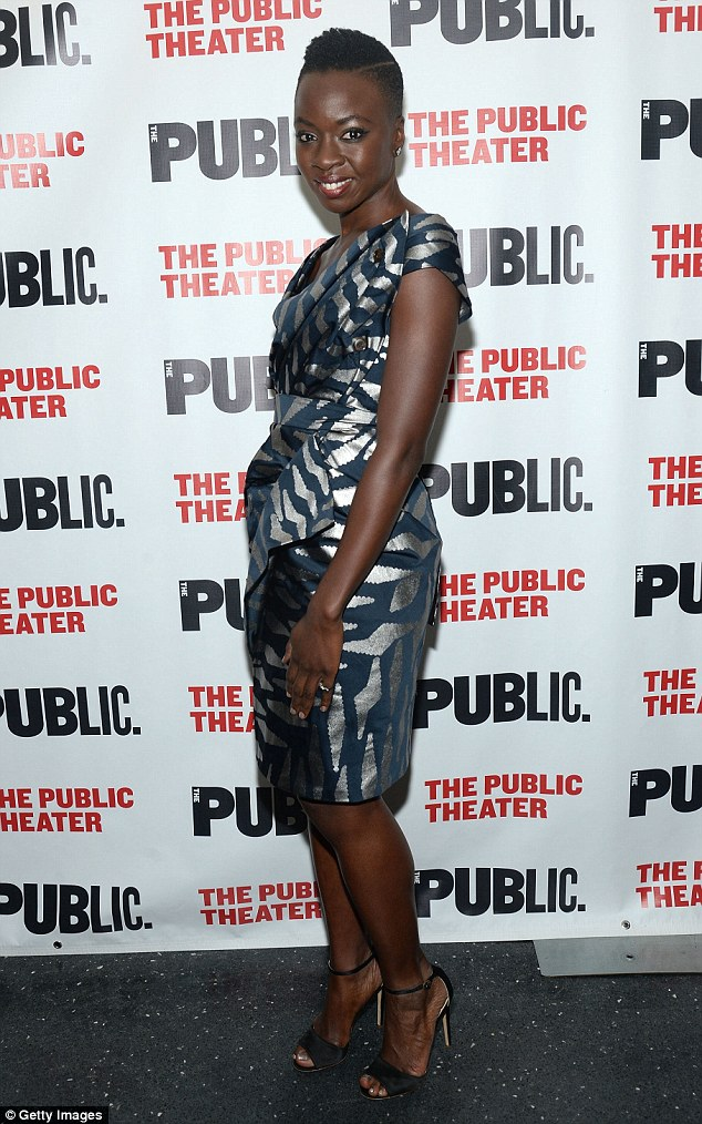 Stylish: Actor and playwright Danai wore an elegant blue and silver dress with dark heels