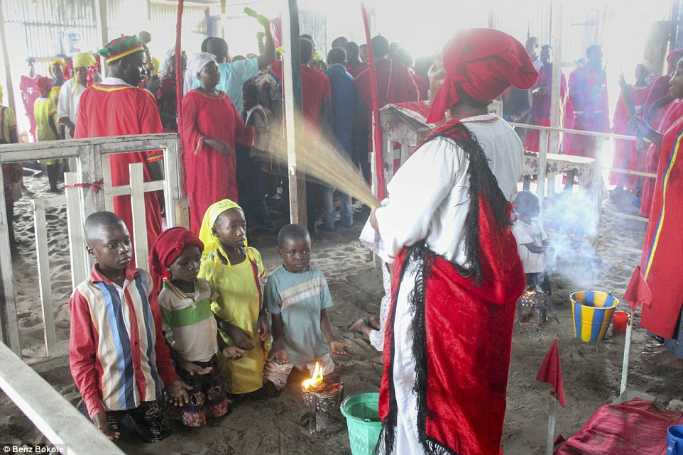 The old religion: It isn't just the Catholic priests who carry out exorcisms. Traditional healers also rid children like these of evil spirts