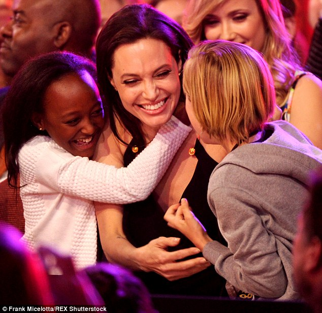 Her pride and joy: The Oscar winner, who revealed she feels 'grounded as a woman' after going through menopause at an early age, is pictured here with Zahara and Shiloh at the Kids Choice Awards in March
