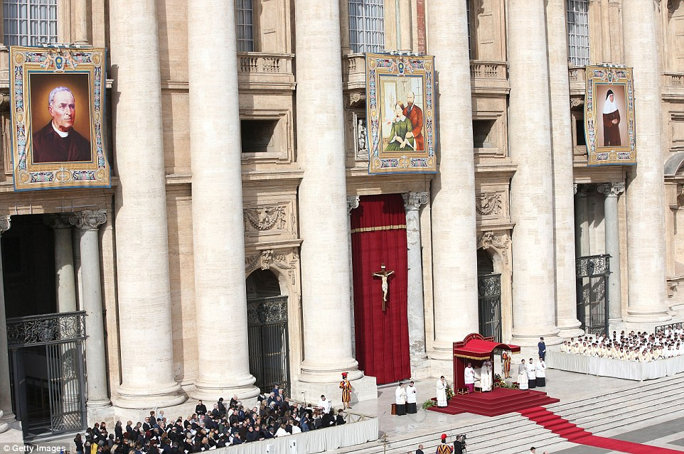 Portraits of the four new saints hung high above Pope Francis during today's special service in front of thousands of pilgrims