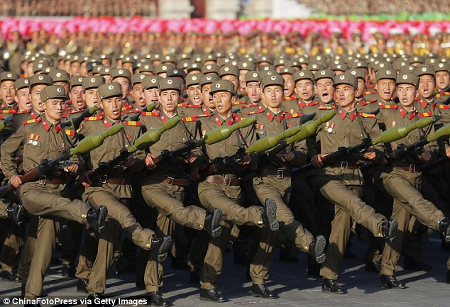 He said that in stark contrast to the West which has a cultural free market, the state controls book publishing in North Korea, pictured is a military parade