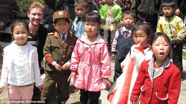 University of Sydney doctoral student Christopher Richardson (left) pictured with North Korean children