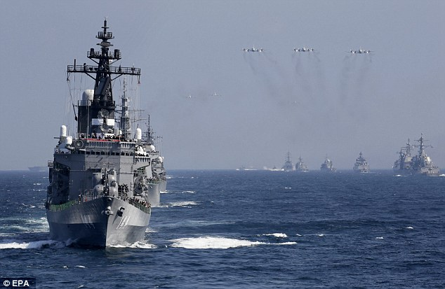 A Japanese destroyer leads a fleet of navy vessels and aircraft during the fleet review held at the weekend