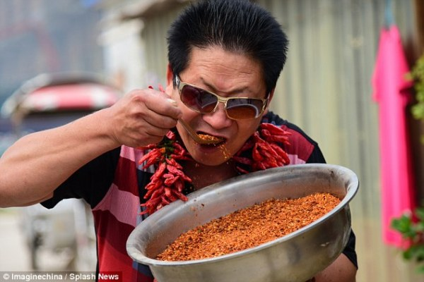 Chinese man eats more than 5lbs of chillies every day and ...