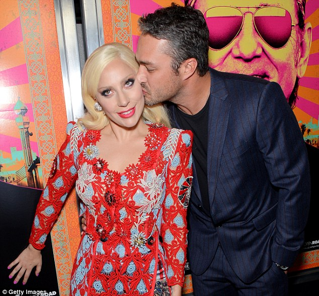 Smooch fest:Lady Gaga and Taylor Kinney showed their love for each other as they packed on the PDA at the Rock The Kasbah premiere in New York City on Monday evening