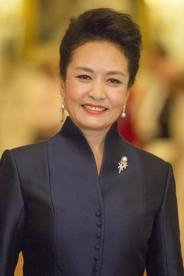 52-year-old Peng Liyuan wore a sophisticated blue tailored gown with mid-length sleeves and high collar set off with a white belt and clutch, and a pearl and diamond brooch and drop earrings