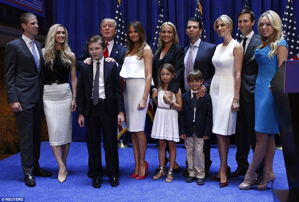 'Trump'ing the competition: Donald poses for a family photo after announcing his run for the White House in June. He's currently the front-runner in the race to be president