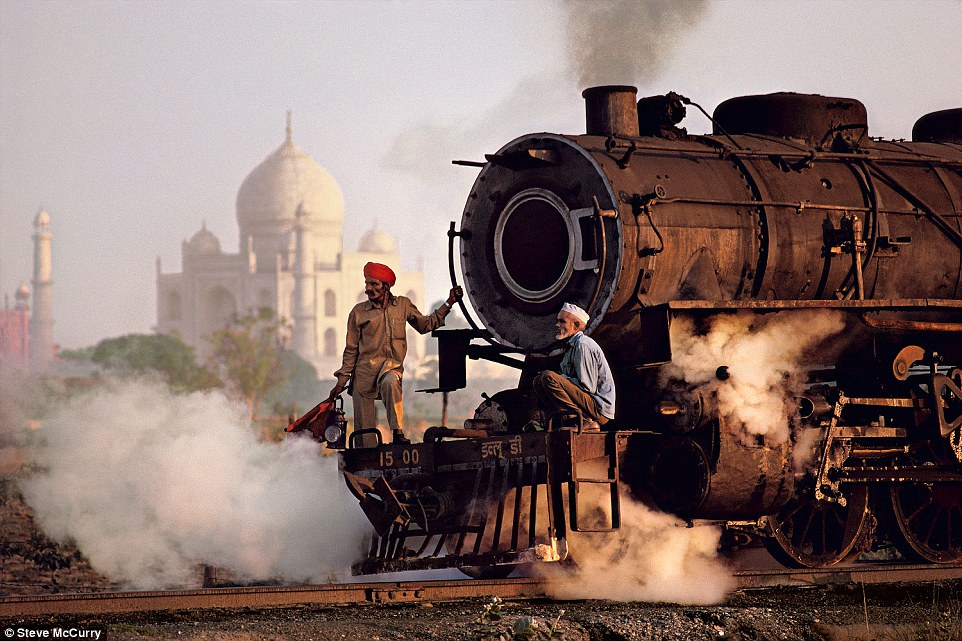 Agra, Uttar Pradesh, 1983. McCurry said: 'This photograph recorded in 1983 the contrast between a mighty technology - the steam locomotive - and the transcendent aesthetic of the Taj Mahal'
