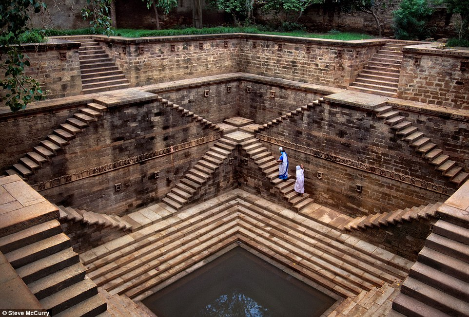 India, 2002. Women climb up mesmerizing stepwells.The magnificent underground structures were ancient forms of water storage and provide respite from the heat and temples