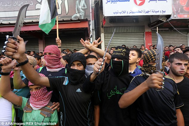 Palestinians demonstrate on the streets at an anti-Israeli protest in Jabalia in the Gaza Strip