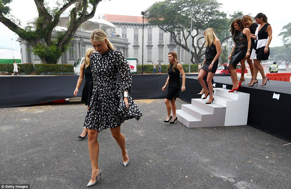 Sharapova steps out ahead of her fellow tennis professionals at the the official photoshoot for the BNP Paribas WTA Finals