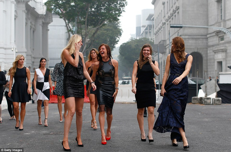 Kvitova shares a joke with Radwanska (centre) as they walk away from the Old Supreme Court Building in Singapore