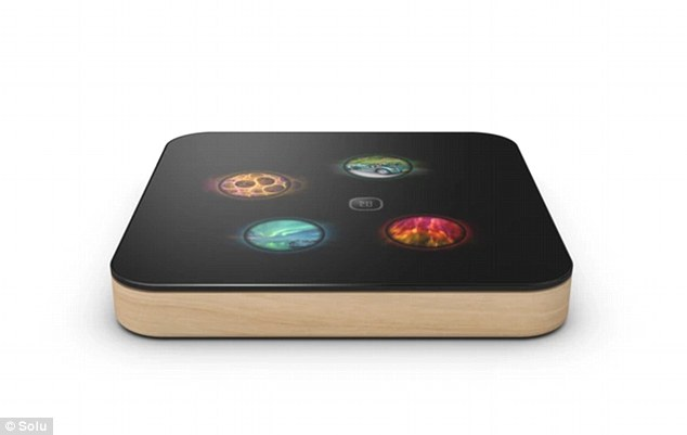 The Finnish firm behind the computer said: 'Solu is an exceptionally beautiful and innovative cloud-linked computer. 'You will never again need to worry about your hard drive, backing up files, or installing software - Solu does it all for you.' An image of the coaster-sized computer with a wooden case is shown above