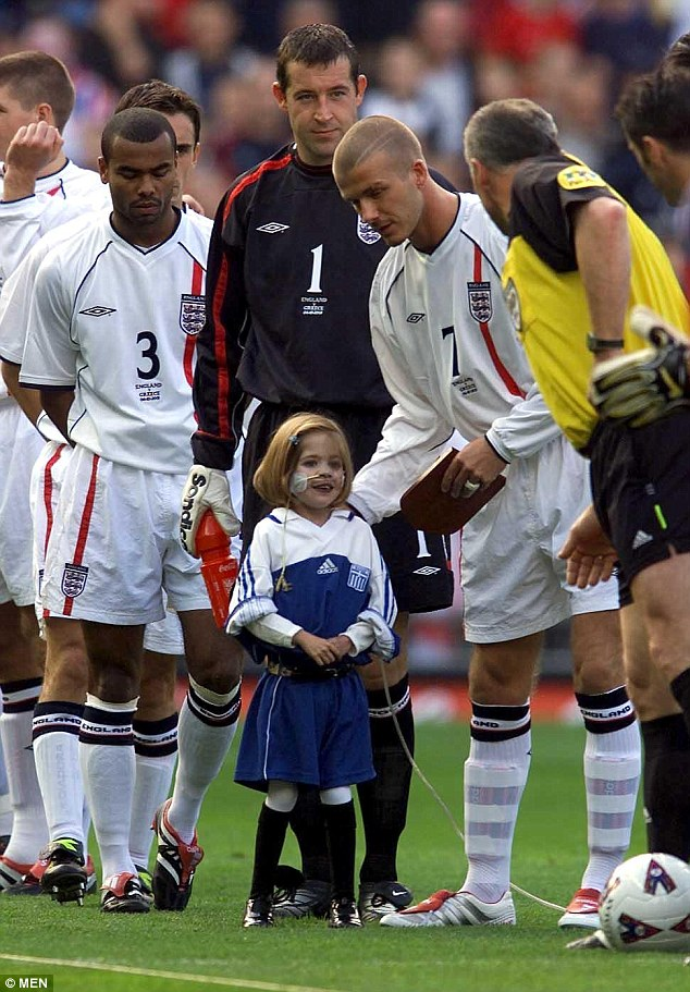 Touching: Kirsty, who was born with a back-to-front heart, won legions of fans in 2001 when she accompanied Beckham onto the pitch with her oxygen tank as the mascot for England's World Cup qualifier against Greece