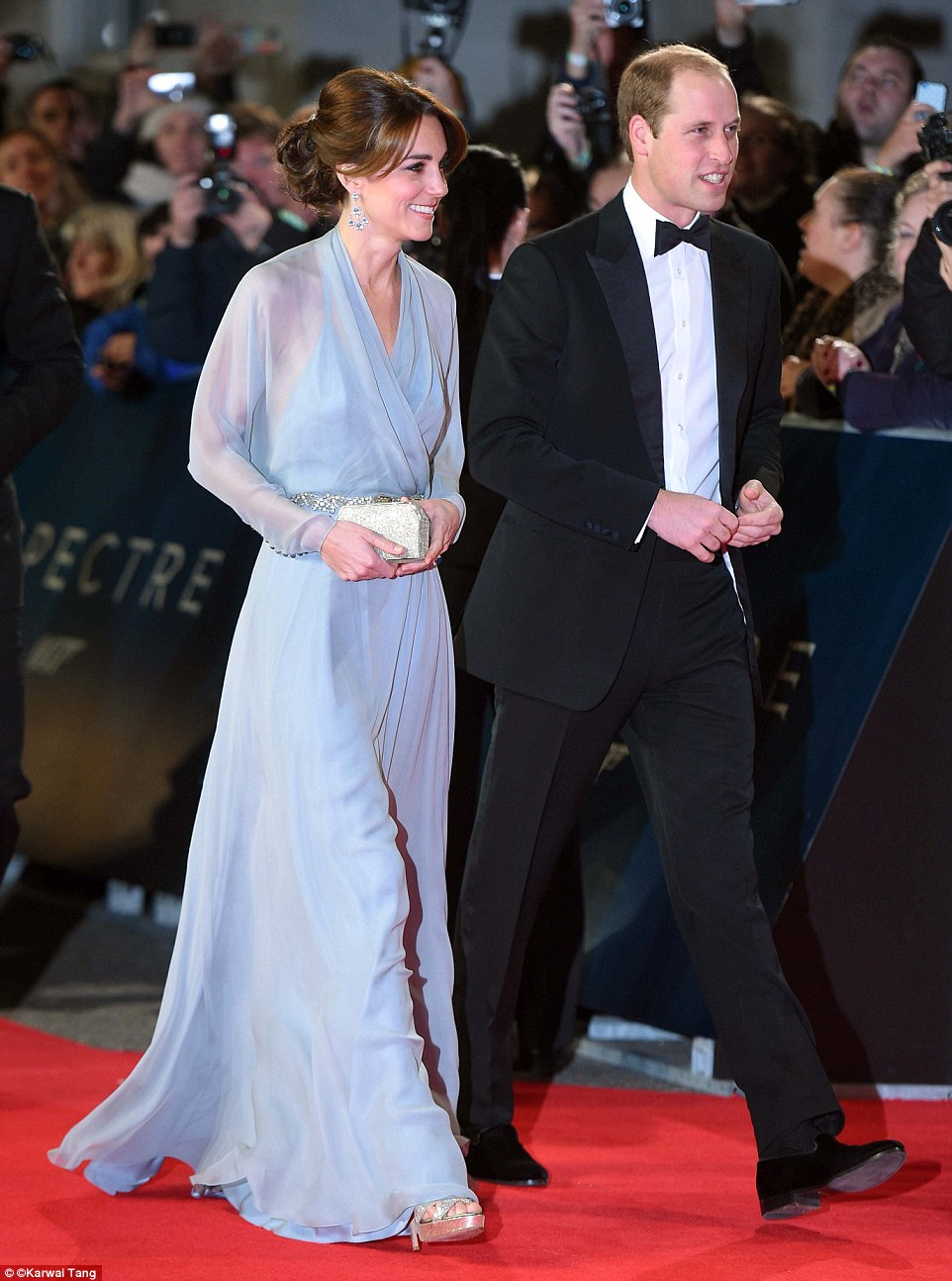 Fans of the franchise: The crowd at the premiere had their cameras at the ready as the Royal couple arrived
