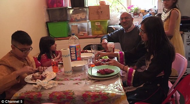 The father sits down to eat dinner with four of his children. He said they can spend £300 a week on food