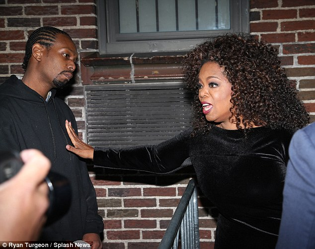 Remember me? After her TV appearance, Oprah was ambushed outside Manhattan's Ed Sullivan Theater by her 'long lost son' Calvin Mitchell (L) following a 20-year estrangement