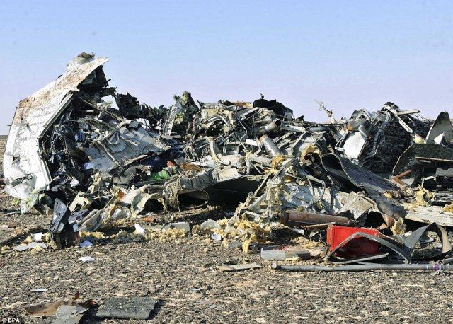 Horrific: This is one of the first images of the mangled wreckage of the Russian passenger jet that crashed yesterday, killing 224 people