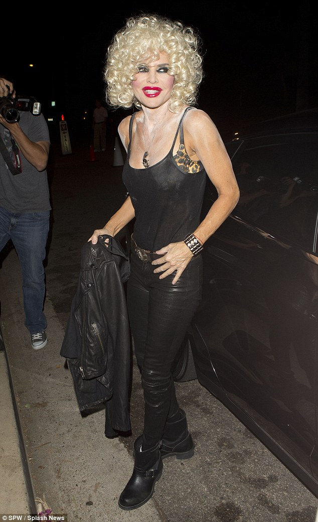 Messy: Rinna had on a black tank top that exposed her leopard print bra. Her blonde wig made her almost unrecognizable