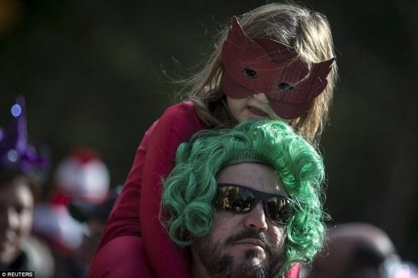 Halloween revelers from superheroes to killer clowns ...