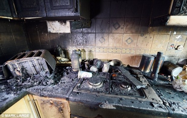 Mr Hodkinson, a courier, said:'It's lucky both of us got out of the house when we did. We dread to think what might have happened. The kitchen (pictured) is blackened and the rest of the house is smoke damaged'