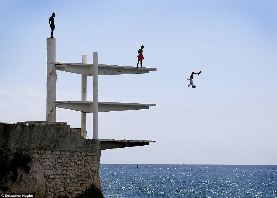 Travel - Honourable mention: Summer day on the French Riviera, by Sebastien Nogier. 'Young men diving into the Mediterranean on a hot summer's day in Nice, southern France. I took this picture in July 2014, in temperatures of about 28C'