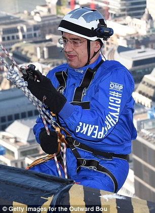Sir Michael Hintze during a charity abseil last month