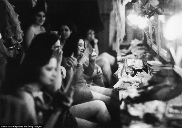 The performers had their own dressing rooms to get stage-ready for their flamboyant performances. Here dancers jokes together in 1930