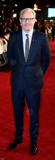 Main man: DirectorFrancis Lawrence proudly walked the red carpet, flashing a wave to the excited crowds