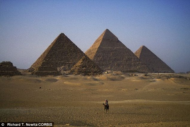 The most famous Egyptian pyramids are those found at Giza (stock image) on the outskirts of Cairo. Several of the Giza pyramids are counted among the largest structures ever built, with the Pyramid of Khufu being the largest in Egypt. It is the only one of the Seven Wonders of the Ancient World still in existence