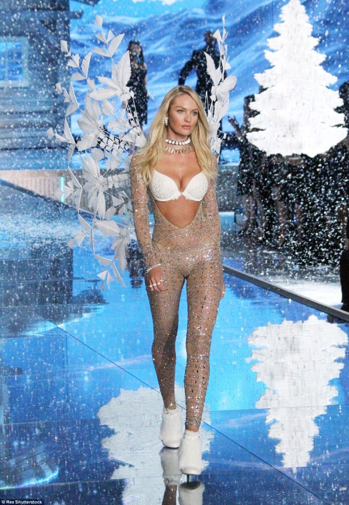 Angelic: For the end of the show Candice sparkled in a glittering jumpsuit, cut with a plunge to the navel, to expose her white bra