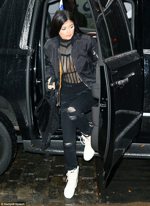 Popping out: The youngest Jenner-Kardashian proudly bared her boobs in the risque number and almost fell victim to a nipple-slip wardrobe malfunction as she deliberately wore her bomber jacket unzipped to show off her assets