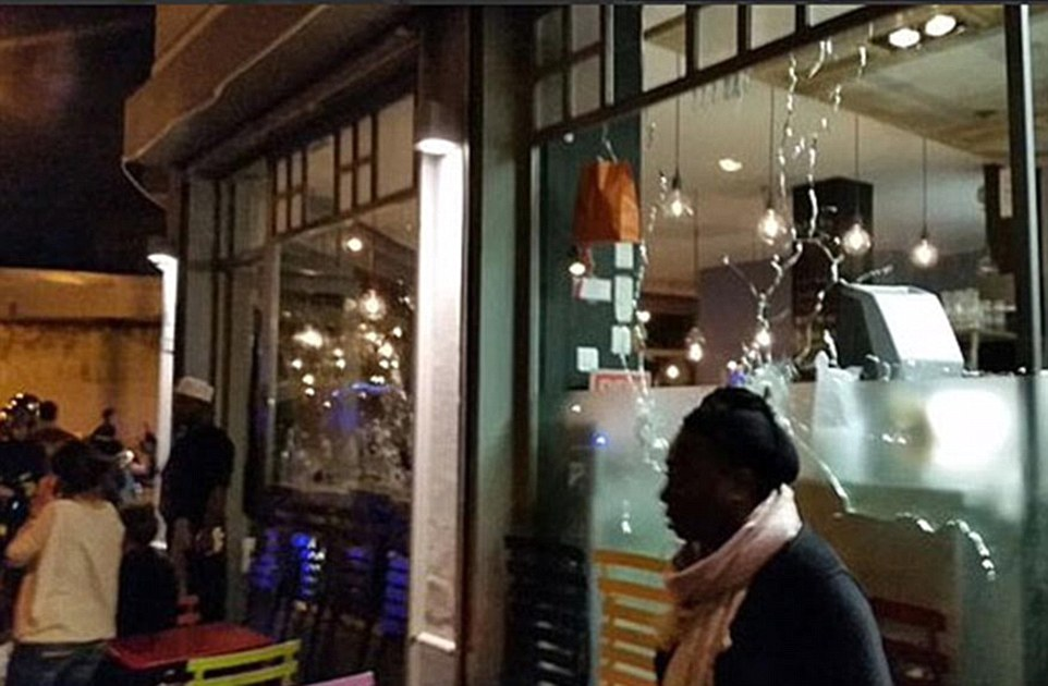 Images posted online showed the cracked windows of what appeared to be the restaurant under attack