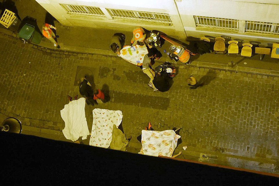 Bodies litter the streets of a Paris alley after a string of terror attacks in the French capital which led President Francois Hollande to declare a national state of emergency