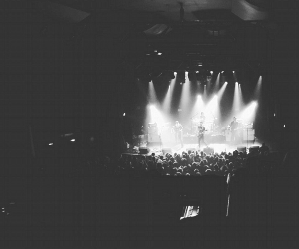 Above, a photo of the band during their show at the Bataclan before the terrorist attack thought to have killed at least 100