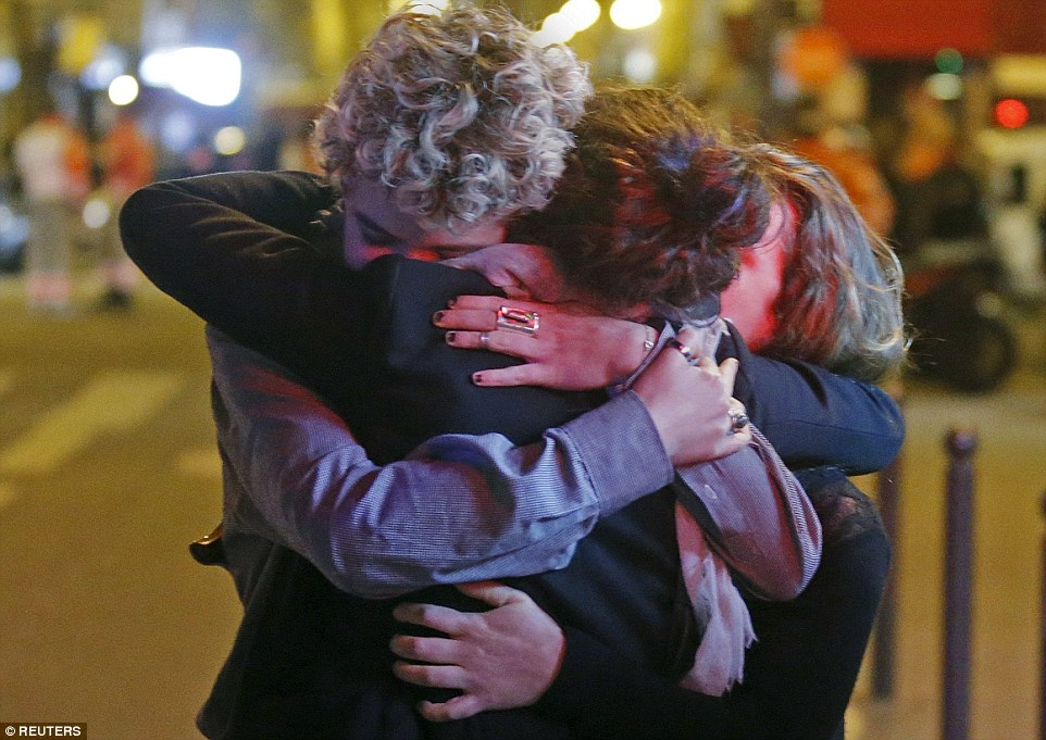 Some at the Bataclan concert hall escaped through an emergency exit, while others left through the roof and went to an adjacent apartment. Above, a trio embrace each other after the attacks