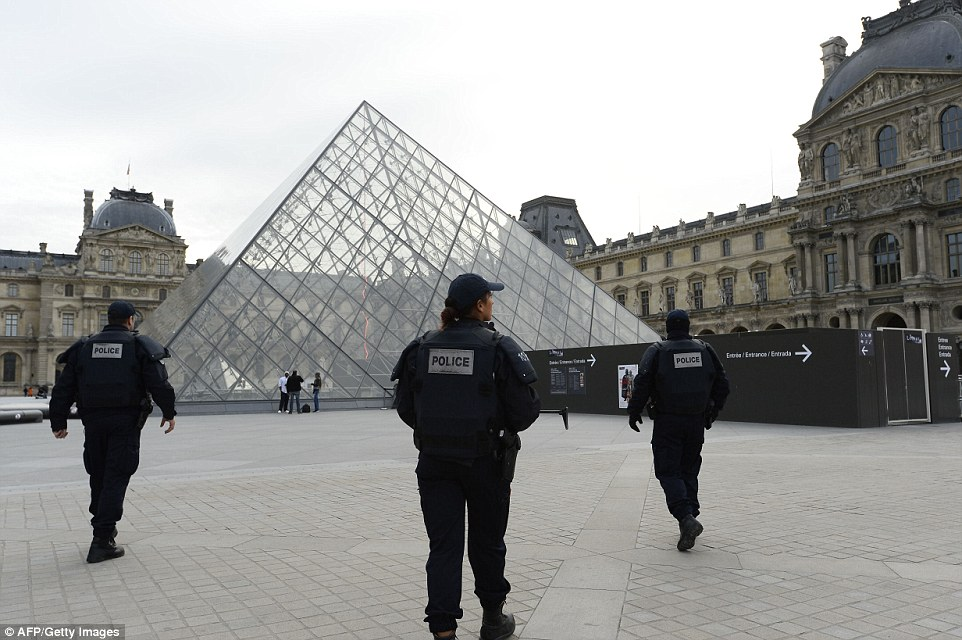 Police patrol in front of the Louvre Pyramid at the Louvre museum in Paris as the country was placed in a nationwide state of emergency