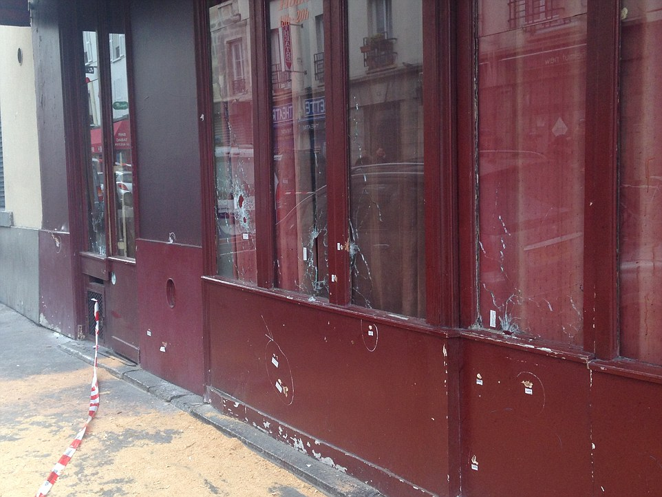 Windows at the Cambodian restaurant Le Petit Cambodge are peppered with bullet holes after being targeted by ISIS fanatics