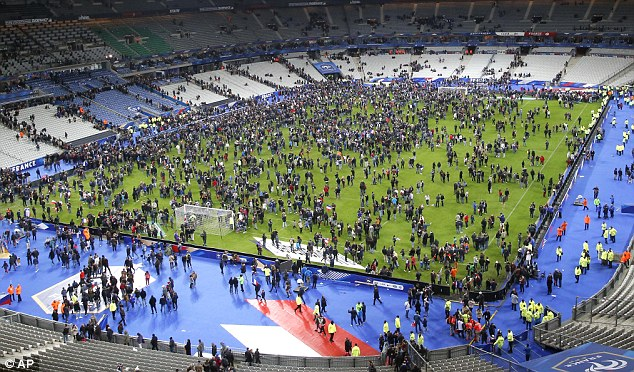 After the match between France and Germany ended, several fans invaded the pitch and decided to stay inside the safety of the stadium
