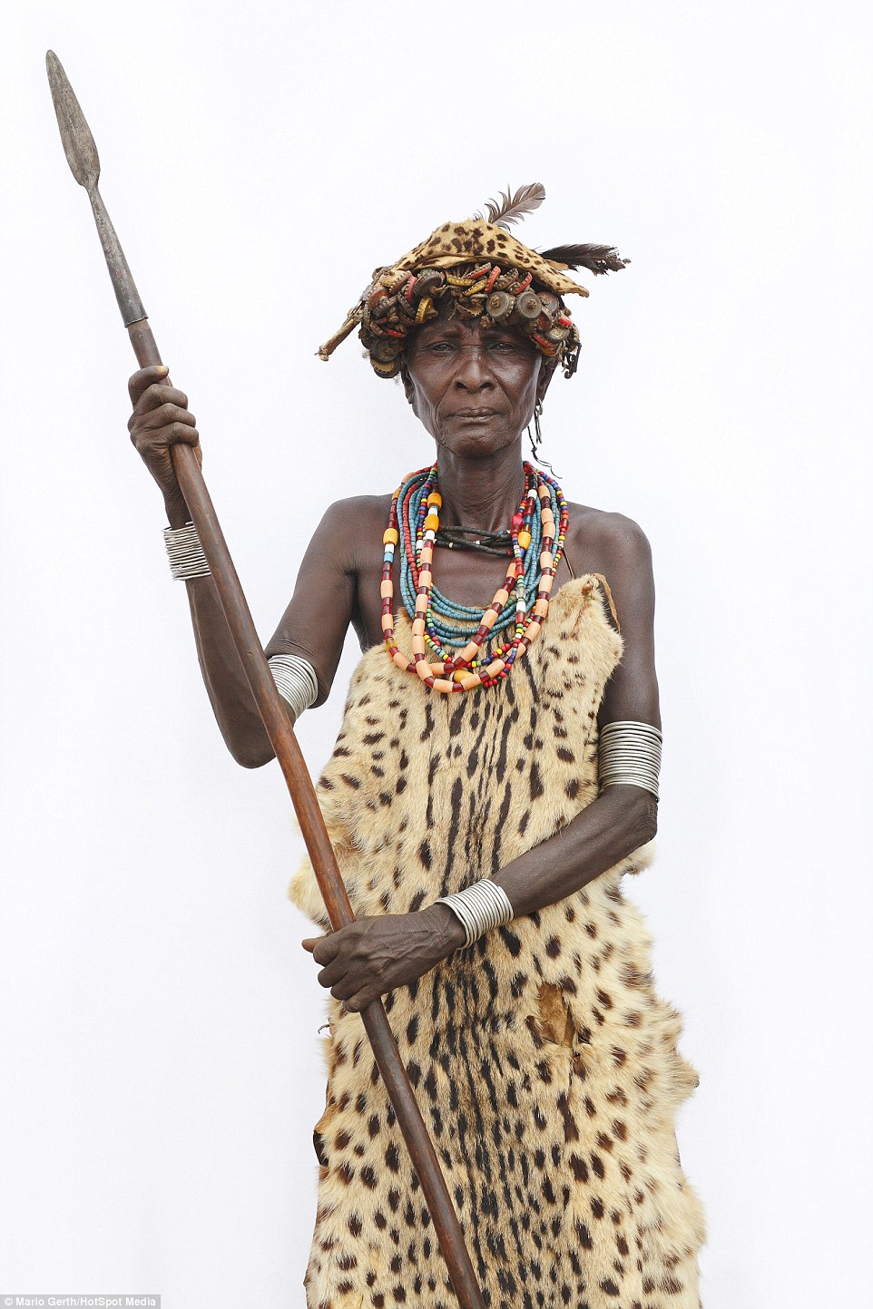 An elderly woman of the Dassanech tribe in Ethiopia brandishes a hunting spear. In many tribal societies older people are revered and given higher social status than the young