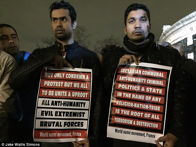 Taking a stand: The demonstrators (pictured), who were all of Bangladeshi origin, held up banners and yelled: Unite against brutality, unite for humanity!'