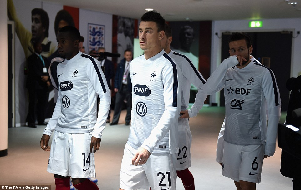 Arsenal defender Laurent Koscielny leads the French team onto the Wembley pitch for their warm-up before the match