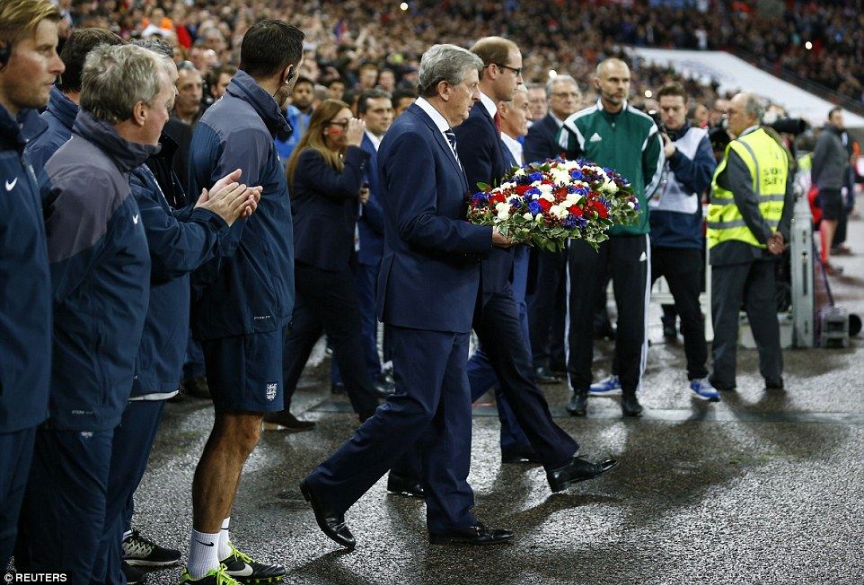 Hodgson, Prince William and Deschamps laid floral tributes in memory of the victims of the terrorist attacks in the French capital