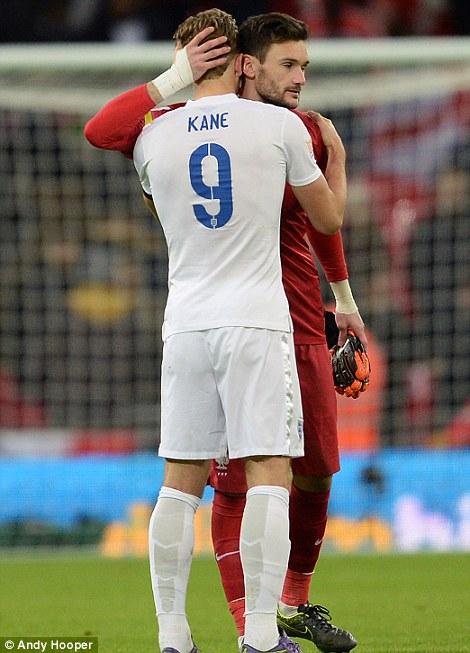 Tottenham team mates Harry Kane of England and Hugo Lloris of France embrace at full time