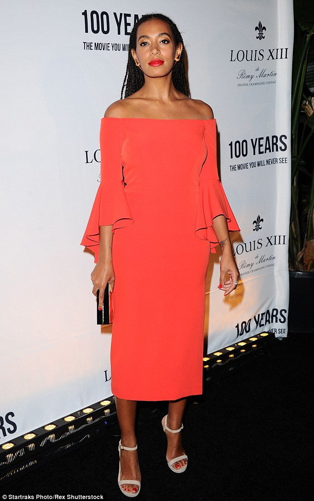 Never shies from colour! Solange - a sometime singer and DJ - showcased her signature bold fashion in an off-the-shoulder coral dress featuring belled sleeves and nude stilettos